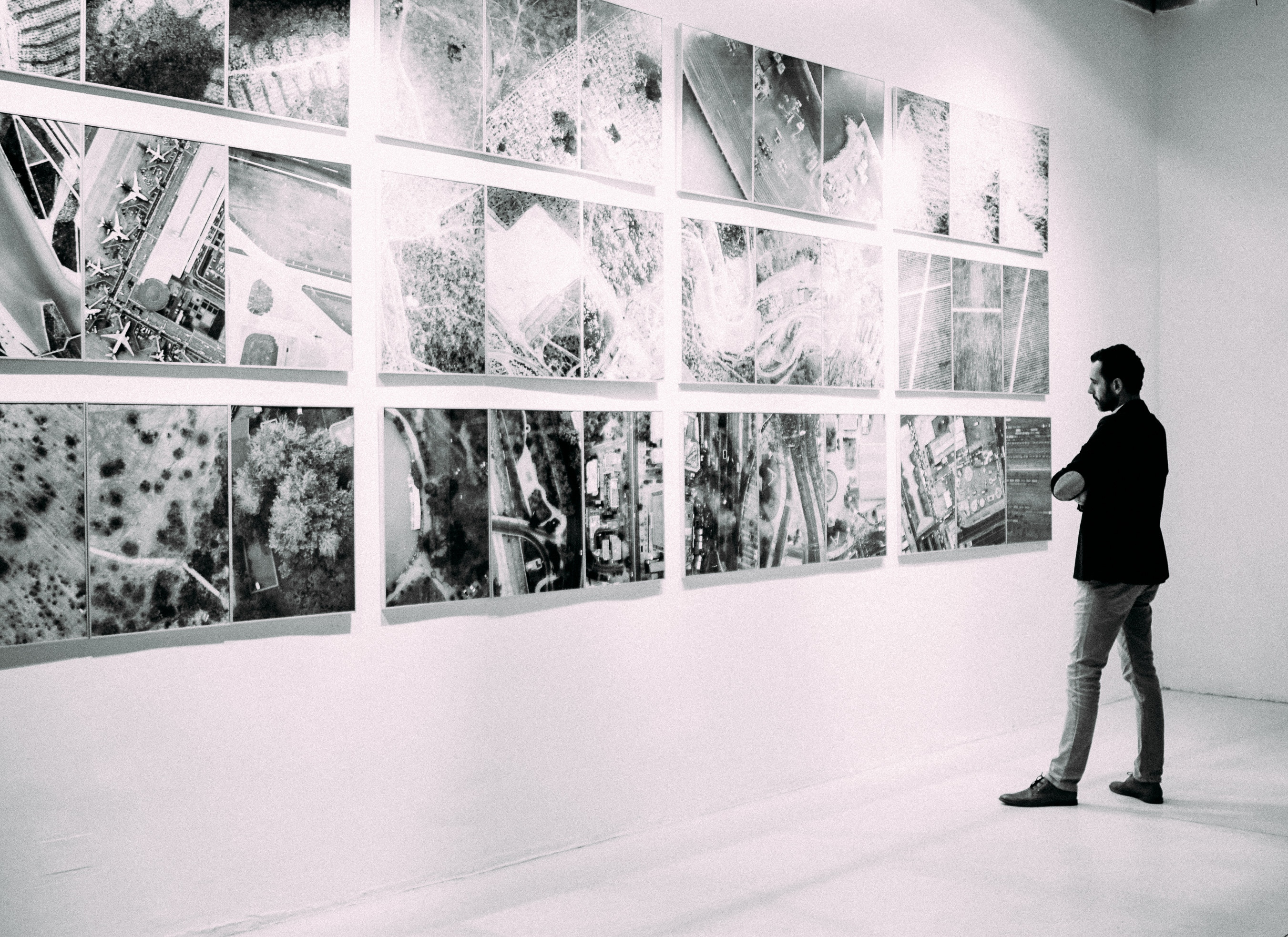 picture of man looking at art objects